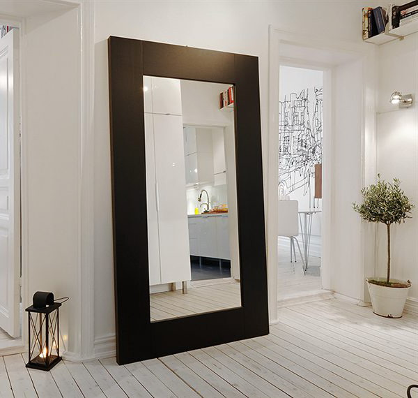 decorating hallway with floor hugging mirror