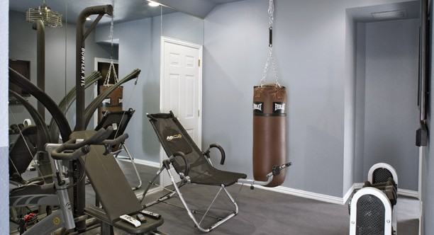 contemporary home gym in the basement