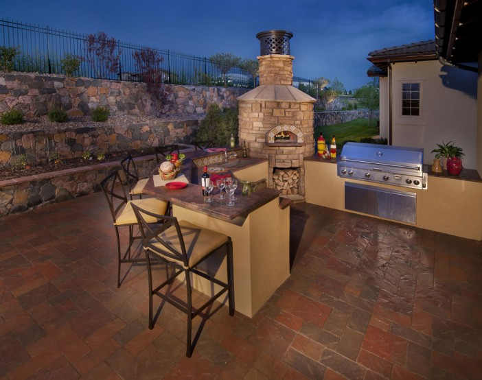 mediterranean rear patio with pizza oven
