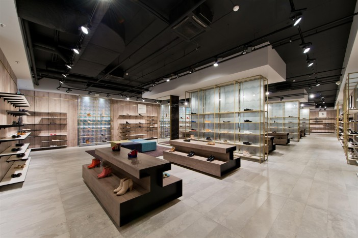 Retail Store Design Ideas inspiring luxury design shop cafe designs classic innovative fashion shop interior design inspiration Considering The Shape Of The Floor Plan The Concept Of Segmenting The Space Into Two Zones Captures The Identity Of The Store The Frontal Faade Facing